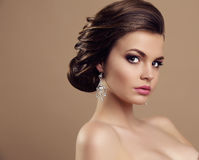 Beautiful  woman with dark  hair and bright makeup, with bijou Royalty Free Stock Photos