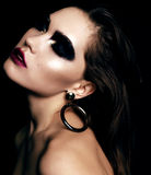 Beautiful woman with dark hair and extravagant black smokey eyes makeup Royalty Free Stock Photos