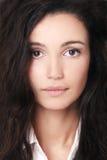 Beautiful woman with dark hair Stock Photos