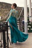 Beautiful woman with dark hair  in luxurious silk dress Stock Photography