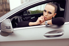 Beautiful woman with dark hair posing in luxurious auto Royalty Free Stock Images