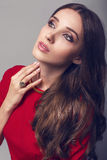 Beautiful woman with dark hair in red dress Royalty Free Stock Image