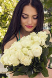 Beautiful woman with dark hair with roses Royalty Free Stock Photography