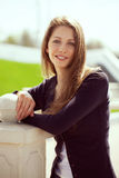 Beautiful woman in a dark pullover Stock Images