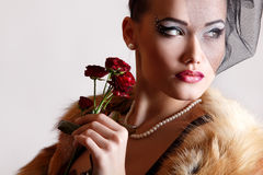 Beautiful woman with dark red roses Royalty Free Stock Photography