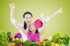 Beautiful woman and daughter with vegetables Stock Photo