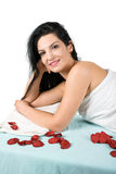 Beautiful woman at day spa. Beautiful brunette woman lying on massage table at day spa,more spa photos in Spa,aromatherapy ,massage Royalty Free Stock Photo
