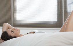 Beautiful Woman Daydreaming While Lying In Bed Stock Photography