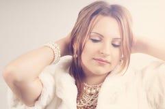 Beautiful woman daydreaming. Beautiful woman wearing pearls daydreaming Stock Photography