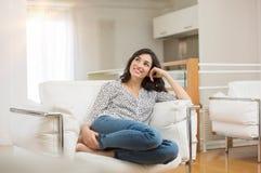 Beautiful woman daydreaming Stock Photo