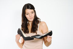 Beautiful woman deciding between two shoes Stock Photo