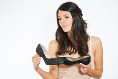 Beautiful woman deciding between two shoes Stock Photos