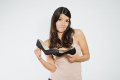 Beautiful woman deciding between two shoes Royalty Free Stock Photo