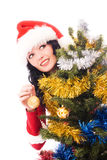 Beautiful woman decorates a Christmas tree. Beautiful smiling brunette woman decorating a Christmas tree isolated against white background Stock Images