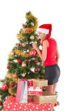 Beautiful woman decorating the Christmas tree Royalty Free Stock Photo