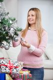 Beautiful Woman Decorating Christmas Tree Royalty Free Stock Photo