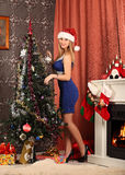 Beautiful woman decorating the Christmas tree Royalty Free Stock Images