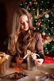 Beautiful woman decorating a present Royalty Free Stock Image