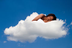 Beautiful woman deeply asleep and dreaming on Cloud nine Stock Photography