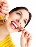 Beautiful woman with a dental floss. Royalty Free Stock Photography