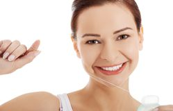 Beautiful woman with dental floss. Stock Images