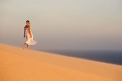 Beautiful woman in desert. Sand dunes. Stock Images