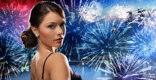 Beautiful woman with diamond earring over firework Royalty Free Stock Photo