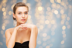 Beautiful woman with diamond earrings Royalty Free Stock Photos