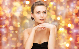 Beautiful woman with diamond ring and earrings Stock Photography