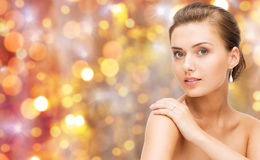 Beautiful woman with diamond ring and earrings Royalty Free Stock Photo