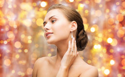 Beautiful woman with diamond ring and earrings Stock Images