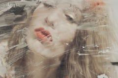 Beautiful woman through dirty glass Royalty Free Stock Photo