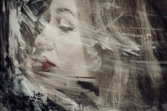 Beautiful woman through the dirty glass closeup Royalty Free Stock Images
