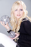 Beautiful woman with disco balls in hand Stock Images