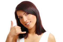 Beautiful woman displaying the call me gesture Stock Image