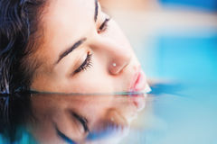 beautiful woman dives in swimming pool Royalty Free Stock Image