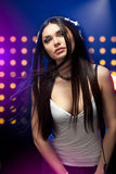 Beautiful woman dj wearing headphones Royalty Free Stock Image