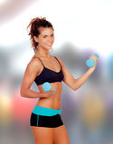 Beautiful woman do toning exercises. With dumbbells royalty free stock photos