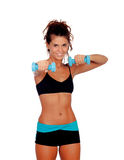 Beautiful woman do toning exercises with dumbbells Stock Photo