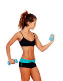Beautiful woman do toning exercises with dumbbells Stock Images
