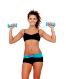 Beautiful woman do toning exercises with dumbbells. Isolated on a white background royalty free stock photos