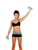 Beautiful woman do toning exercises with dumbbells. Isolated on a white background stock image