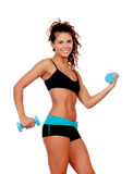 Beautiful woman do toning exercises with dumbbells. Isolated on a white background royalty free stock photography