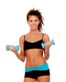 Beautiful woman do toning exercises with dumbbells. Isolated on a white background stock photo