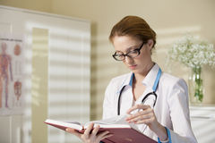 Beautiful woman doctor with book Royalty Free Stock Photo