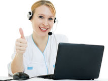 Beautiful woman doctor consultant shows ok stock photography