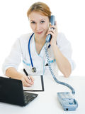 Beautiful woman doctor consultant with telephone Stock Photo