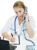 Beautiful woman doctor consultant with telephone Royalty Free Stock Photos