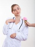 Beautiful woman doctor with a flower. Stock Image