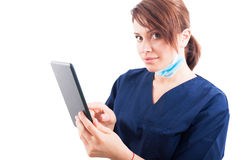 Beautiful woman doctor holding a wireless tablet Stock Photo